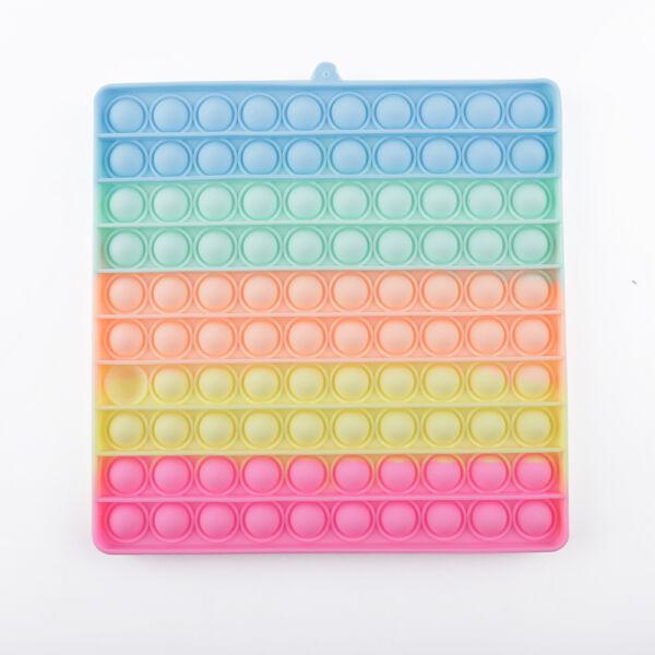 Pop it! játék élénk szivárvány színben, neon négyszög